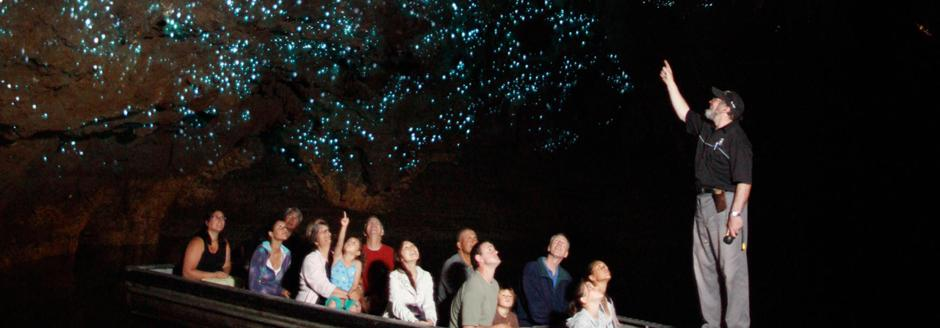Group of people exploring the glowworm caves in waitomo