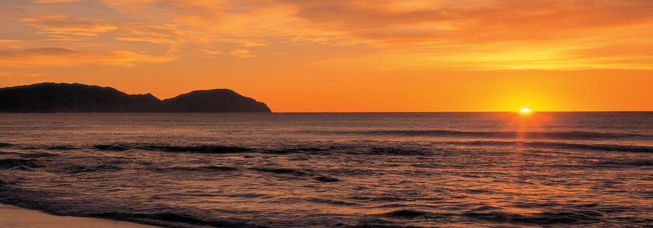 sunrise at wainui-beach