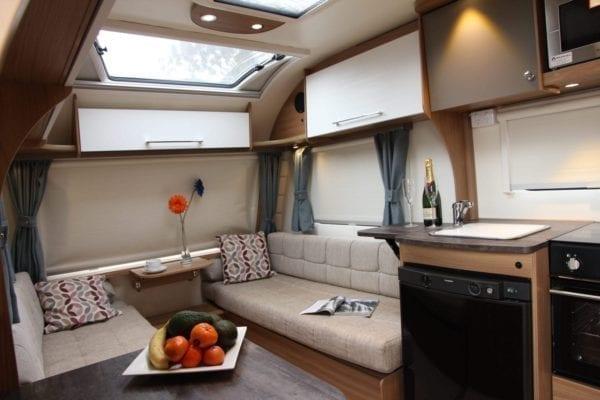 Pursuit 2 berth caravan lounge and kitchen