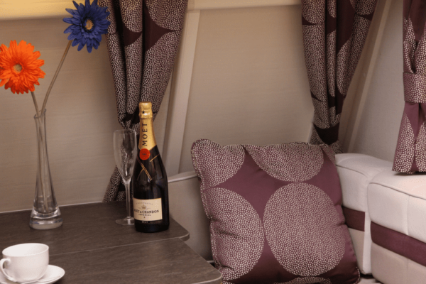 Conquest 2 wine and cushions